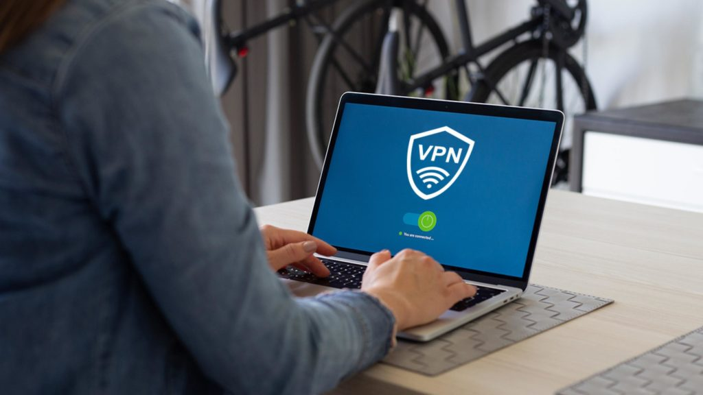 Picture of someone using a vpn service from a laptop